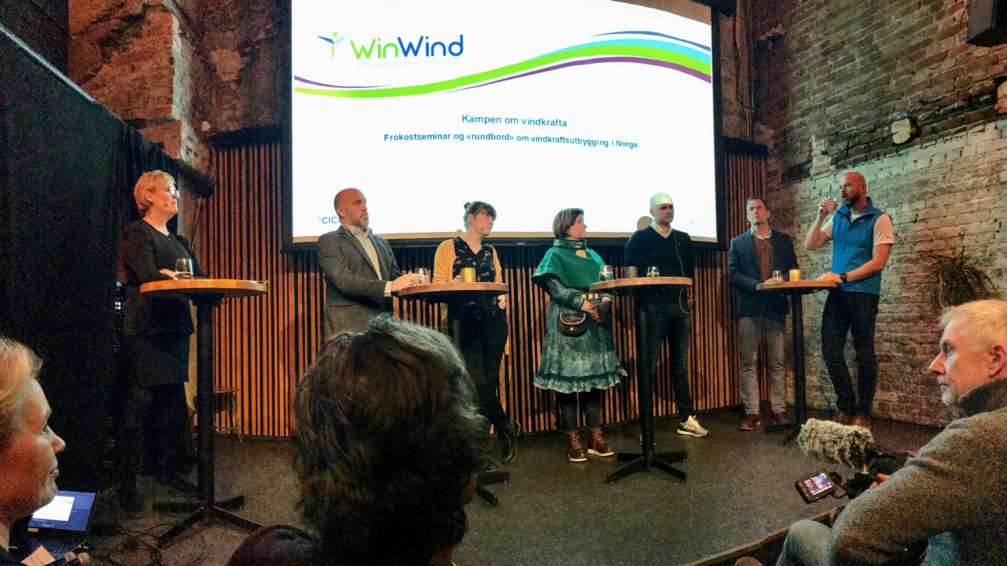 The debate organised by cicero and nve clearly showed that there is large disagreement on whether more wind power capacity should be developed in norway. From left to right: kristin halvorsen (CICERO), Thomas Bjørdal (LNVK), Silje Ask Lundberg (Friends of the earth norway); Aili Keskitalo (sami parliament of norway), Bengt Eidem (TrønderEnergi), Marius Holm (ZERO) and Dag Terje Solvang (The norwegian tourism organisation). Photo by Iselin Rønningsbakk / CICERO.