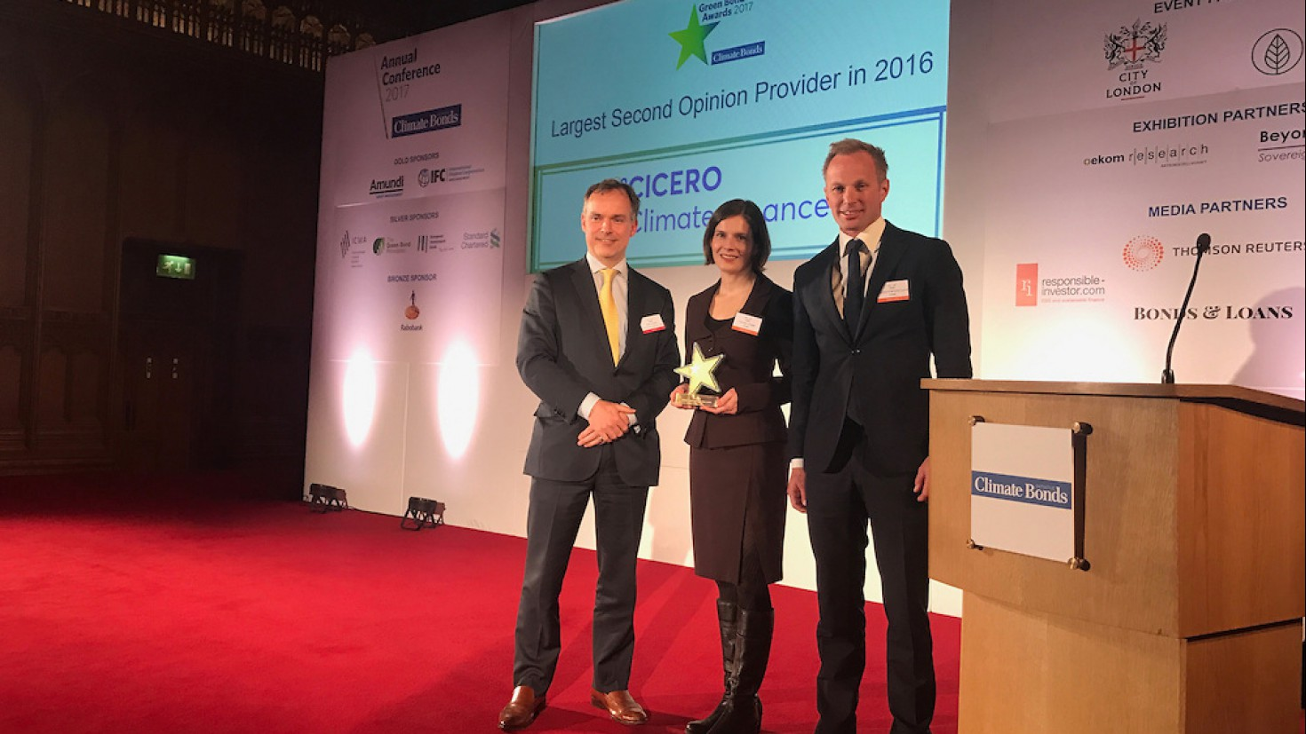 "christa clapp and Harald Francke lund (to the right) accepted the award for ""largest second opinion provider in 2016"" on behalf of cicero climate finance."